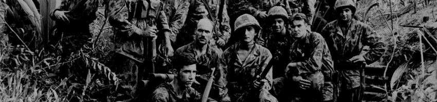 They are U.S. Marine Raiders gathered in front of a Jap dugout on Cape Totkina on Bougainville