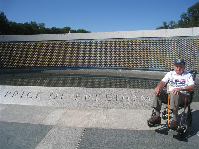 "Bob Lamp remembers ""the price of freedom"" at the World War II Memorial's Wall of 4,000 Stars representing and honoring the 400,000 men and women who lost their lives defending our nation in battle."