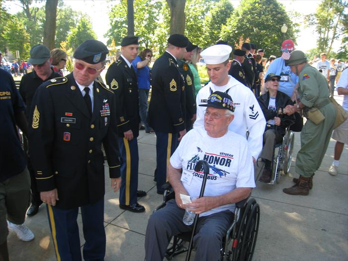 WW II Veteran Bob Hickman gets a hero's welcome and military + civilian greeting line as he enters the World War II Memorial in Washington, D.C.