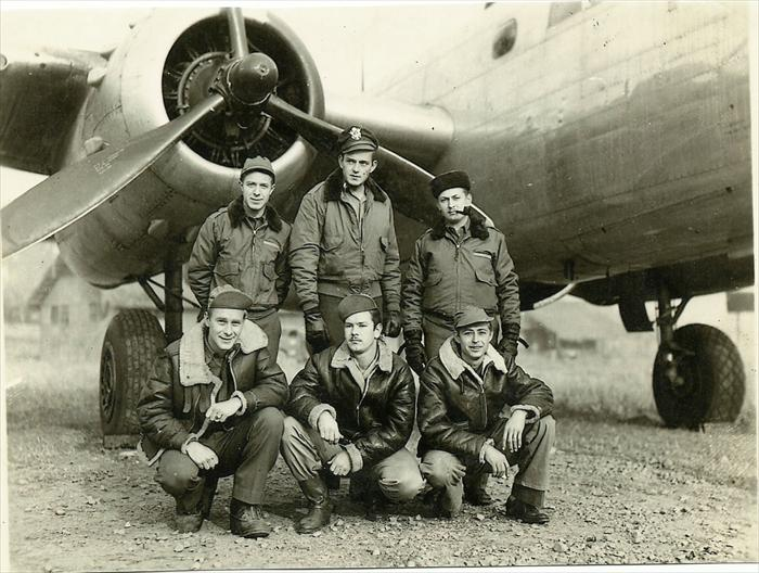 photo of boys from Birmingham Alabama in front of a B-25 from their squadron