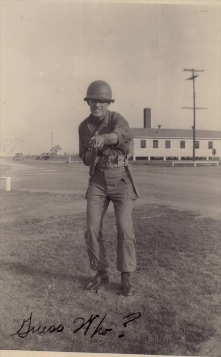 "Here's Dad.  ""The building you see is the guard house.  The guards sleep there.  So far I have not had the honor of being on guard duty.""