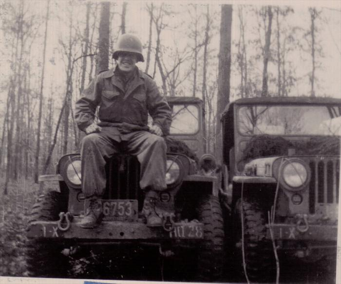 Unidentified soldier on maneuver.  Dad's 1st ID HQ CO, 1951 license plate.