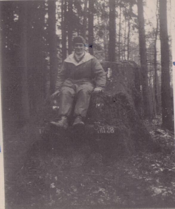 John Tubinis, PFC, 1st ID HQ CO, on maneuver, Germany.  Sitting on top of a jeep.  1951-1953.