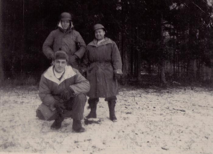 Dad, stooped, Smitty and Cpl. Clarence Werre (at right), on maneuver in Germany, 1951-1953.  Dad wrote on the back of the photo the men were awarded white scarves for so much time on maneuvers.