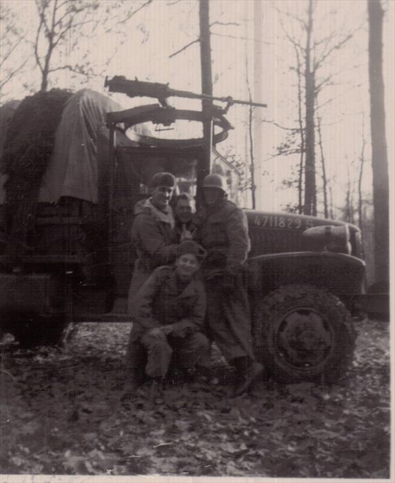"Dad (left,) ""English, ""Stretch"", Iusiak (stooped) on maneuver, 1951-1953, Germany."