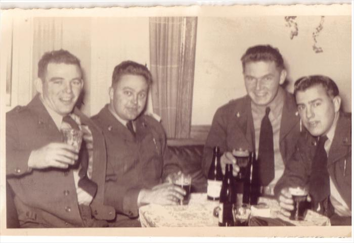 "Taken when the 1st Inf. Div. was headquartered in Darmstadt.  Left to right-Smitty (Frederick J. Smith), Ray Byers, Stretch (John Moskites) and Bence Whitley. All but Smitty are with us today.  Bence Whitley, HQ CO defense platoon, requested to go to Korea.  He died as ""SGT 179 INF 45 INF DIV"" in Korea one day after his 23rd birthday in November 1952. It is known he died of an illness."