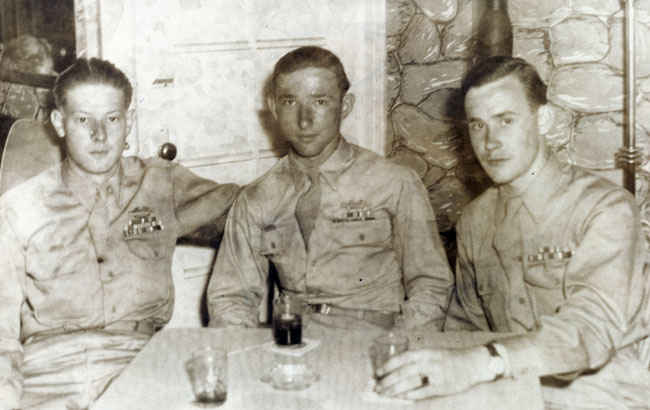 This is the last picture of my grandfather in his Army uniform. This was taken in New York shortly after he arrived on a merchant ship back from Europe, July 1946. Left Roy Brown, Thomas Buettner, Joseph Brooks.