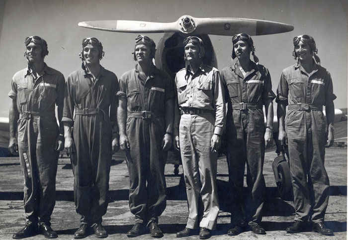 Left in front of the PT19 Fairchild trainer; Woodrow W. Wilson, Donald G. Allen, John O. Pettay, L W Jolly, Arthur E. Newton, Stephen E. VanNostrand.