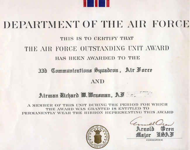 Air Force oustanding unit award to the 33rd Communications Squadron.