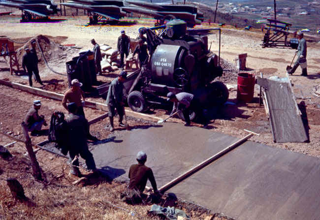 Korean peasants pouring concrete 1973-1974 at B Battery repairing a mudslide that happened the previous year..