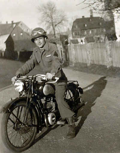 Wolke Staff Sergeant Stanley Flisak on the motorcycle.