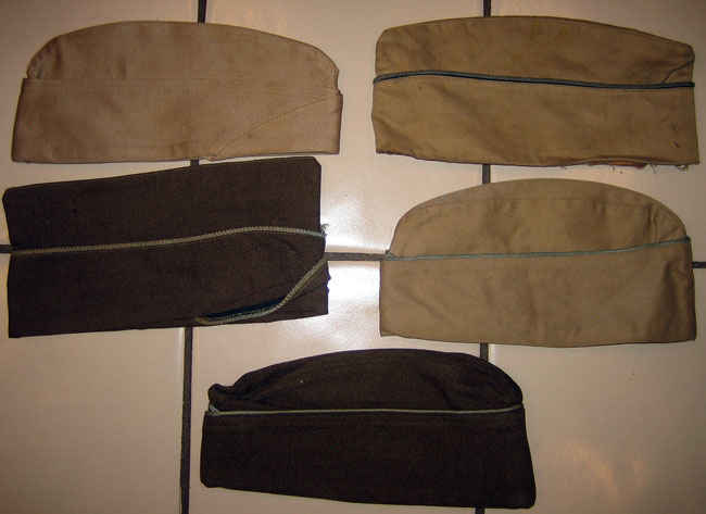 Various colors of army hats worn by my grandfather.