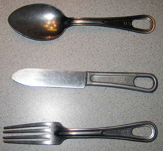 Utensils used by my grandfather. He said that the spoon was the best one and he used it for everything. The spoon is much larger than a tablespoon.