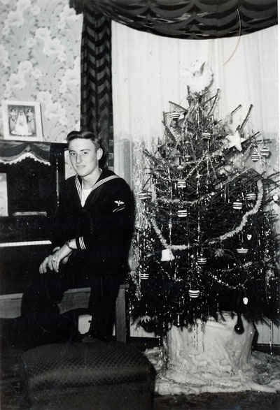 Ellis Gene Buettner on leave from the Navy and home for Christmas.