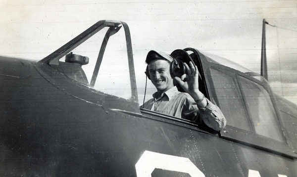Ellis G Buettner at the flight controls of a Hellcat.