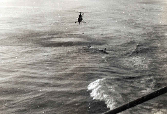 Pilot in the drink after having to bailout. Pilot was safely rescued by the Boxer.