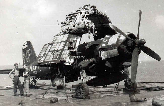 Corsair after the Boxer fire on desk. Many planes were so badly damaged they were pushed over desk.