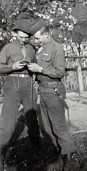 My grandfather was always with Sutton to the right. My grandfather and Sutton examine a pistol.