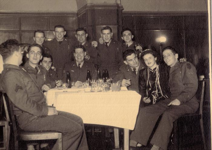 Dad, (John Tubinis), second left, with 1st I.D. HQ CO men at Service Club.  Most likely Darmstadt, Germany 1951.  Smitty with his arm draped around soldiers.