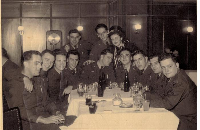 "John Tubinis with 1st Division HQ CO soldiers.  Probably 1951.  Darmstadt, Germany Service Club.  ""Smitty"" drapes his arm around Dad's shoulder."