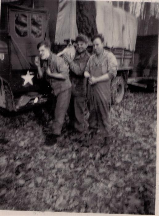 Unknown soldiers and 1st Inf. Div. Hq Co. mascot on maneuver 1951-1953