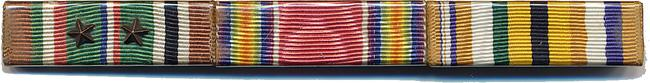 "Medals. European-African-Middle Eastern Campaign Medal, Victory Medal WWII, and Unknown medal. I have reviewed every medal and cannot find it. According to the Order and Medals Society of America, the third ribbon was a privately produced, which went by several names (e.g., Allied Ribbon; Interallied Ribbon). The colors represent those of the WWI allies. The ribbon was used on a few city and local WWI service medals. However Thomas was in WWII not WWI, ""re-use"" of obsolete ribbon stock is one explanation we have been exploring. Another idea is that Thomas might have bought it (he does not remember), as an unofficial ribbon after his military service was over, possibly as part of a veterans association, as a member, it has not been definitely ascertained exactly what it was for at this point in time but it turns up on original U.S. WW2 veterans bars fairly frequently. A few documented U.S. European Campaign Veterans bar sport it. If anyone knows for sure post it on MyWarHistor"
