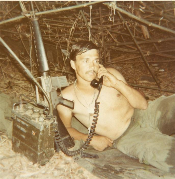 "Eldon with his M-16 and PRC-25 Radio. The ""prick""  was developed in the 1950's. Normal range was of 5 kilometers with the short antenna, up to 8 kilometers long antenna and was powered by a battery that could last about 20 hours."