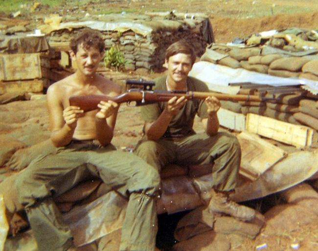 Russian sniper rifle Eldon (right) received for being awarded a purple heart. The rifle was captured during the Cambodian raid.