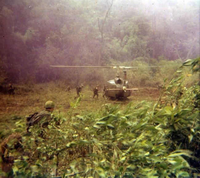 Huey picking up soldiers in Vietnam.