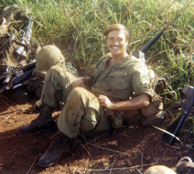 Eldon resting with his M-16 in Vietnam.