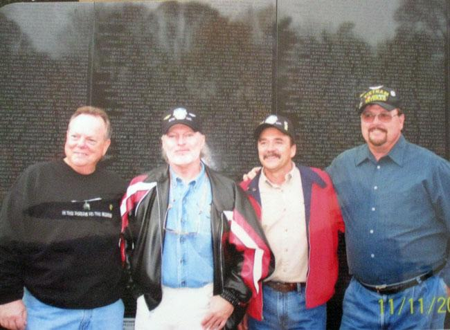 Eldon (3rd left) and Mac Coffman (2nd left) at the Vietnam wall.