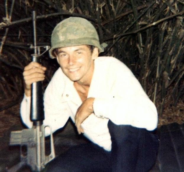 Clothes were sent out to the field so this soldier had to use some local attire in Vietnam.