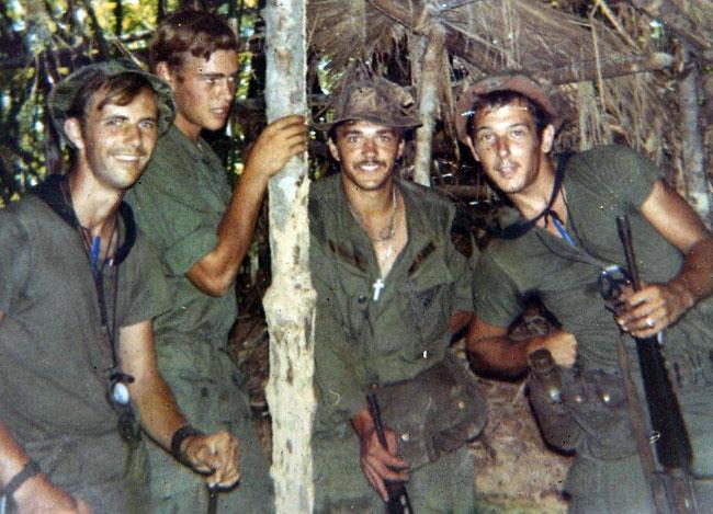 Left Jack, Mike, Eldon, and Dan in Vietnam.