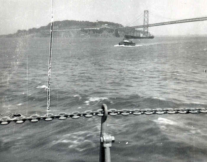 USS Leo going under the Golden Gate bridge to serve in the Korean War.