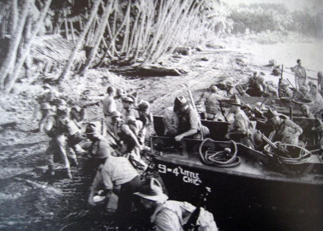 Rushing out of a Higgins boat during the Luzon Invasion. James was part of multiple invasions in the Philippines.