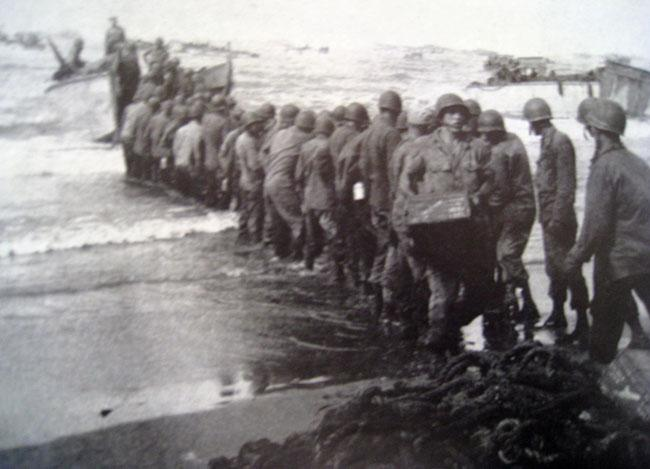 Getting supplies onto the beach during an invasion by the 25th Infantry Division in the Philippines.