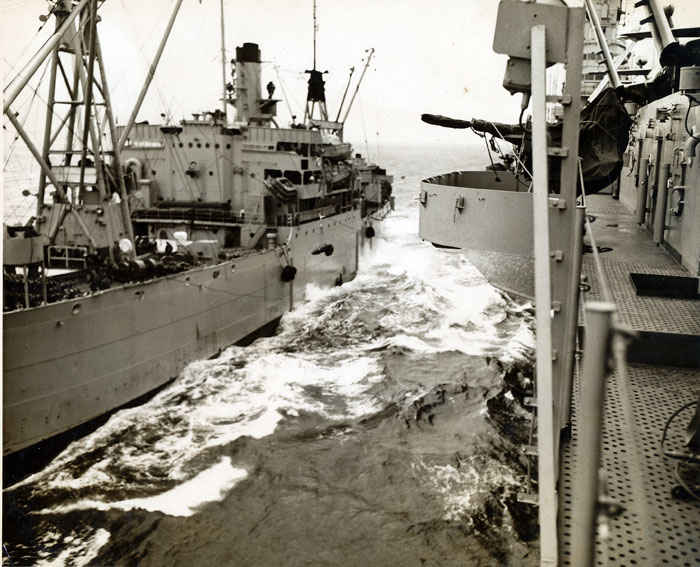 Loading ships full of ammunition at sea was never, a routine task as one can see in this picture, a disaster could happen at anytime via a rogue wave, wind or complacency.