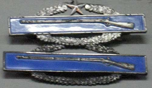 Combat Infantry Badge. Notice one has a star in the wreath, this stands means that Carl was awarded the Combat Infantry Badge because he saw direct fire in two wars. This is very rare.
