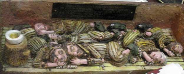 Carving of POWs sleeping in North Korean camps. This was carved by Carl Cossin from one piece of wood. Notice there are no blankets, no beds, no pillows, or any other semblance of humane treatment.