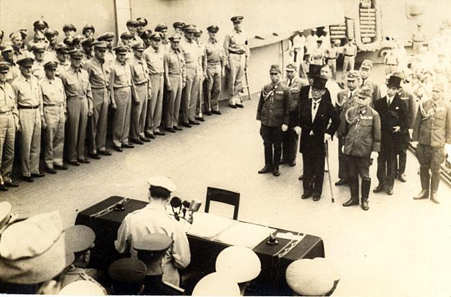 September 2, 1945 Emperor Hirohito signing the document for Japan to formally surrender on the battleship USS Missouri, anchored in Tokyo Bay.