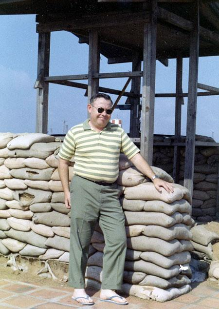 Morris Briggs standing at a revetment on Tan Sun Nhut