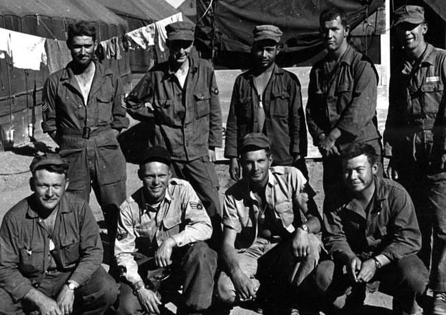 KC-97 tanker crew T-4, at survival training, Stead Air Force Base, NV, 1953: Front row L/R:  Capt. Porritt (Aircraft Commander); survival instructor (?); 1st Lt Worle (Co-pliot); Briggs (navigator).  Back Row:  L/R  M/Sgt Hill (Flight Engineer); Airman 1st Class Klekota (radio operator); Airman 1st Class Hall (boom operator); squadron intelligence airman (?); Airman 2nd Class Swieg (asst. boom operator)