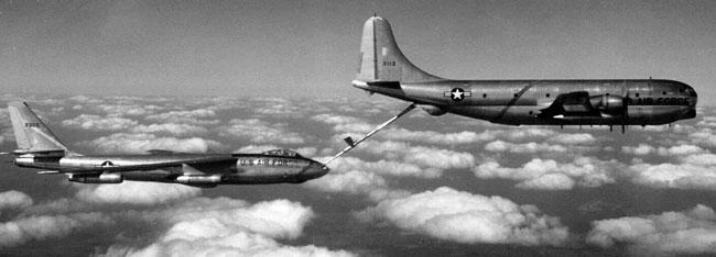 Pix taken from chase airplane showing B-47 taking on fuel from KC-97.