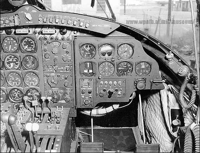 The right side of the cockpit of an RB-26C aircraft. Tunnel to the nose section is below the instrument panel.