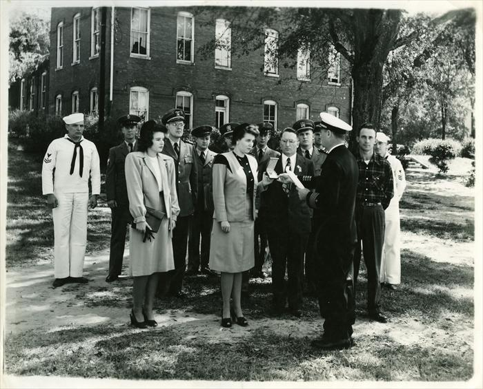 Presentation of the Silver Star Medal to his wife 5 October 1946 Brown Hall, Alabama Polytechnic Institute,  Auburn, AL.  His brother Earl in the plaid shirt.
