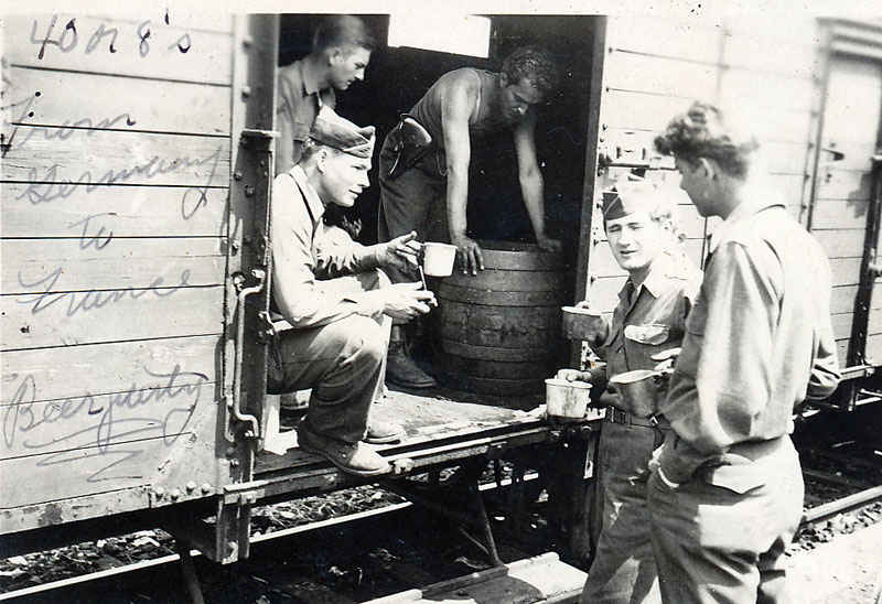 Beer party from Germany to France. This train car is known as the 40's or 8's, which means it, could haul 40 men or 8 horses.