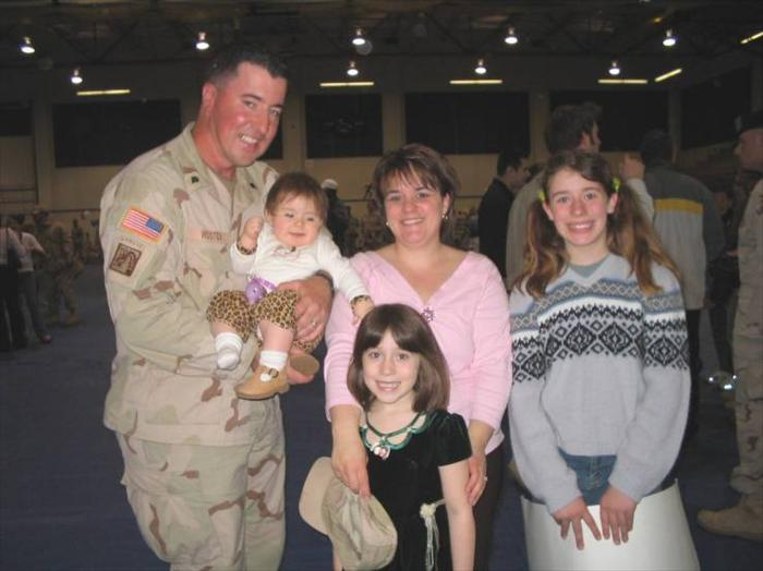 Picture of me and my beautiful family at our 'Welcome Home' ceremony at Fort Lewis, WA., March 2005.