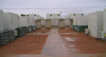 Another pic of our lovely 'hooches' that we lived in the last six months or so during our time at LSA Anaconda.  They had A/C that worked (when we didn't have 'brown outs') and were relatively comfortable.  The only bad thing was if a mortar or rocket landed near one, it turned a hooch into hundreds of bits of flying shrapnel.  That made for a very bad day, indeed!