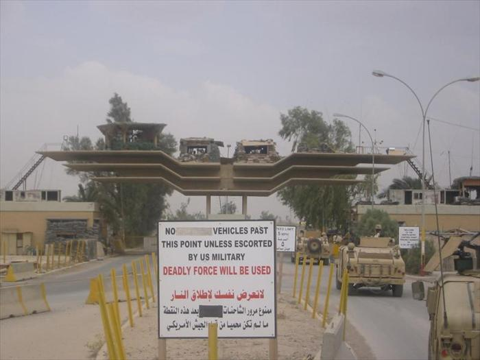 Picture of the North Entry Control Point (NECP) aka 'North Gate.'  This was the primary entry control point of the base and was the main departure and entrance for military convoys.  It was also where civilian and military supply trucks were inspected.