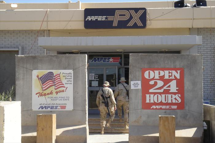 Closeup of Main Post Exchange (PX), notice the large concrete Jersey barriers that are directly in front of the main entrance.  These were erected after a large 122mm mortar hit the front of the PX in June 2004, killing one soldier and wounded dozen or more.